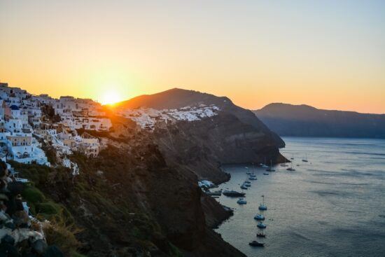 Sun rising above Oia village. Sunrise photo of Santorini island